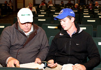 Walker Hancock with Bernie Sams looking on signs his first ticket on Hip 564, 2012 Keeneland November Sale